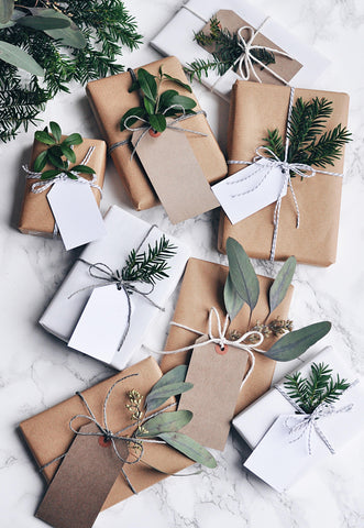 Presents wrapped in plain paper with natural accessories