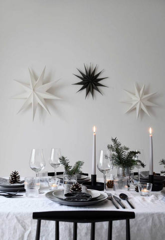 Monochrome Christmas Table with candles and paper stars