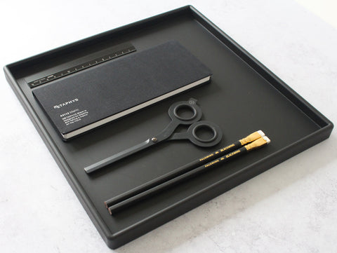 Tray of black stationery