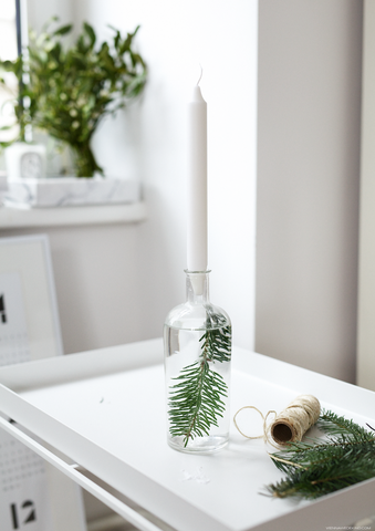 Candle holder with pine spray