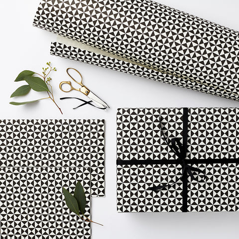 Presents wrapped with monochrome paper