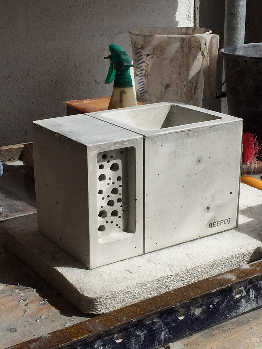 Concrete bee hotel plant pot being finished in a workshop