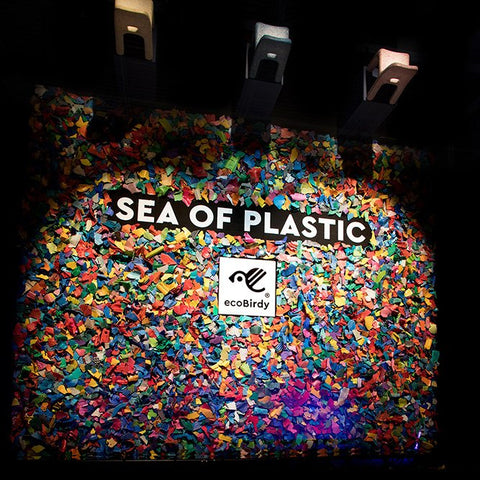Installation made of lots of tiny pieces of brightly coloured plastic