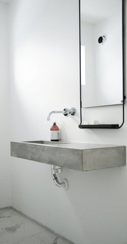 Floating concrete sink with large mirror