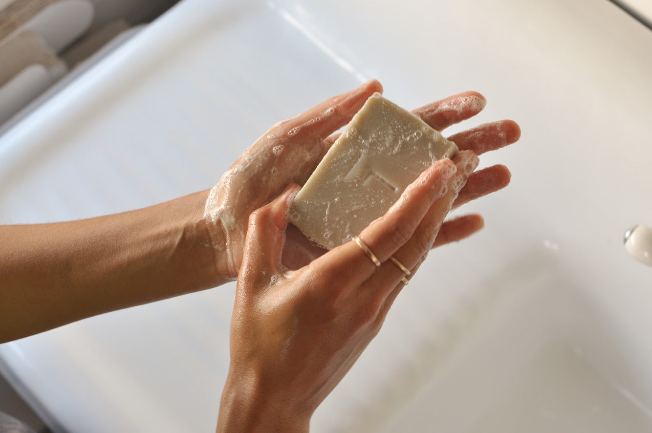 Close up of hand washing with bar soap