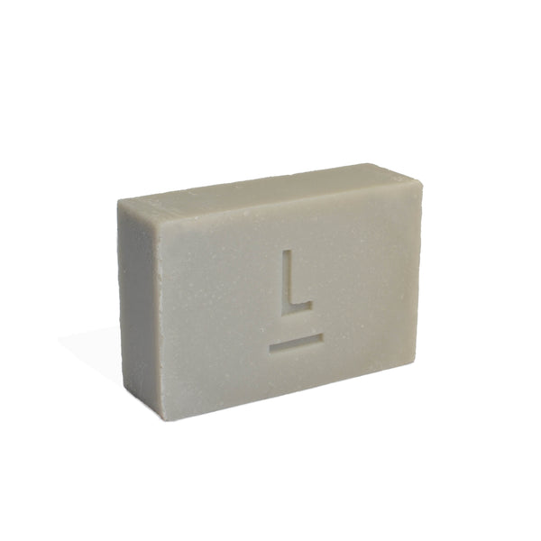 Grey soap bar with letter 'L' logo