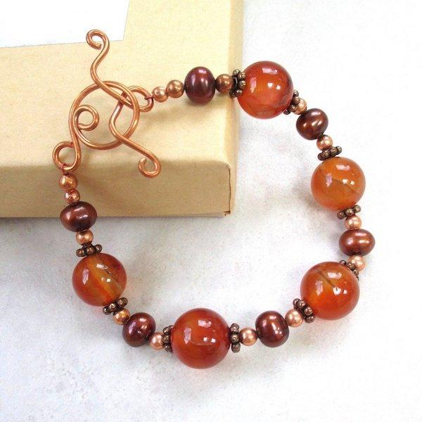 Chunky Bracelet with Orange Gemstones, Bronze Pearls, Copper Toggle Clasp