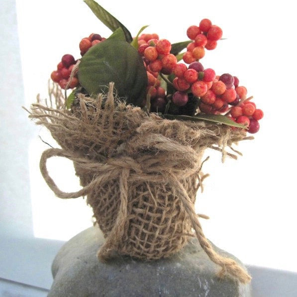 Autumn and Thanksgiving tabletop centerpieces of earth friendly components are ideal for small tables and cozy gatherings. A pair of these eco-friendly, environmentally sustainable accent decorations - in colorful, natural fall shades of red, orange, yellow and green - are handcrafted designs by Rough Magic Creations for Wall and Table Home Decor online shop on Prospero Lane.