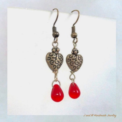 Bleeding Hearts Dangle Earrings with Etched Antique Brass and red glass teardrop dangles. Gifts for her for Christmas, Valentine's Day, birthday, everyday. Made in the USA.