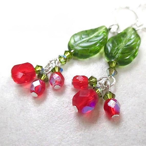 Festive and colorful Christmas Earrings, Holly and Ivy Series, dressy and elegant holiday dangles with green vintage German glass leaves, fine Austrian crystals, fire polished berry red Czech glass beads, silver earwires. Holiday Jewelry for Women, made in America, designed and handcrafted in Down East Maine, USA, by Rough Magic Holidays for J and M Handmade Jewelry on Prospero Lane website.