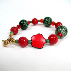 Chunky Christmas Bracelet, Red and Green Holiday Jewelry with Weathered Wood Acrylic Flowers, Leopard skin print globes, green and red accent rounds, gold plated toggle clasp.