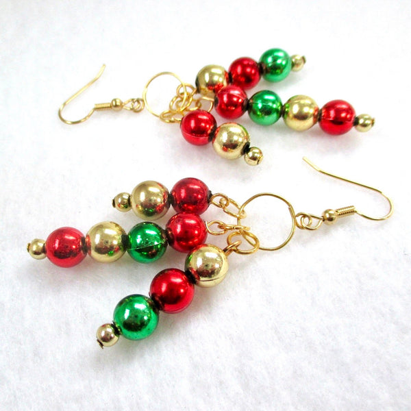 Gold Green & Red Recycled Christmas Ornament Earrings, eco-friendly holiday jewelry for women. Long shoulder duster chandelier dangles with gold, red and green reclaimed upcycled Xmas garland beads, designed by Rough Magic Holidays for J and M Handmade Jewelry, handcrafted in Maine, USA, made in America.