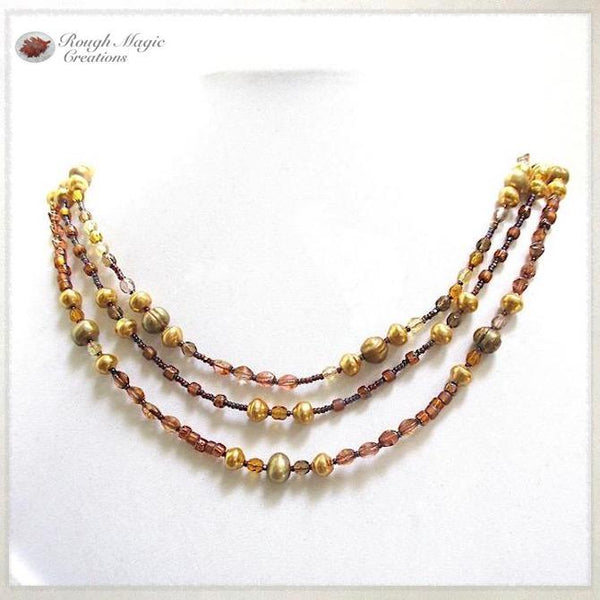 June Birthstone Jewelry Golden Pearl Multistrand Necklace with Copper Color Glass, handmade by Rough Magic Creations.