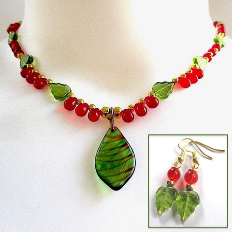 Holly and Ivy Christmas Jewelry Set Handmade Green Red and Gold Holiday Lampwork Pendant on Glass Beaded Necklace, Festive Dangle Earrings, Traditional Winter Colors, Art Nouveau Style, Colorful Woodland Theme. Made in America, Maine, USA by Rough Magic Holidays for J and M Handmade Jewelry on Prospero Lane.