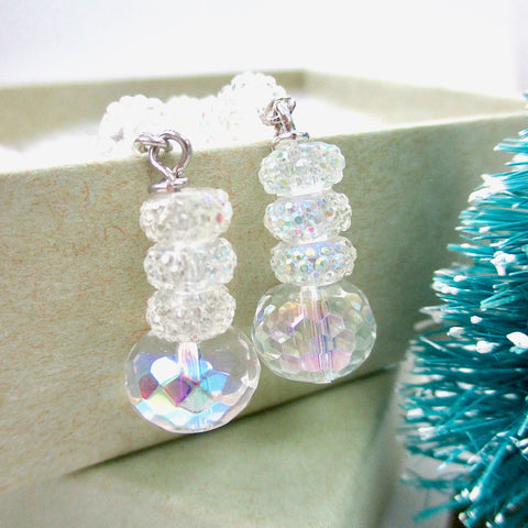 Christmas Holidays and New Year's Eve Glamorous Luxe jewelry for women. Extra long earrings with icy crystal clear dangle drops and silver hook ear wires. Handcrafted by J and M Handmade Jewelry, made in America, Down East Maine, USA.