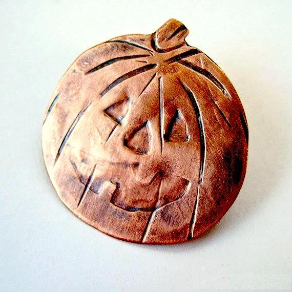 Spooky Halloween Costume Jewelry, Copper Pumpkin Jack o Lantern brooch, hand forged antiqued metalwork jewelry for women, a Rough Magic Holidays design for J and M Handmade Jewelry, made in Maine, USA, America.