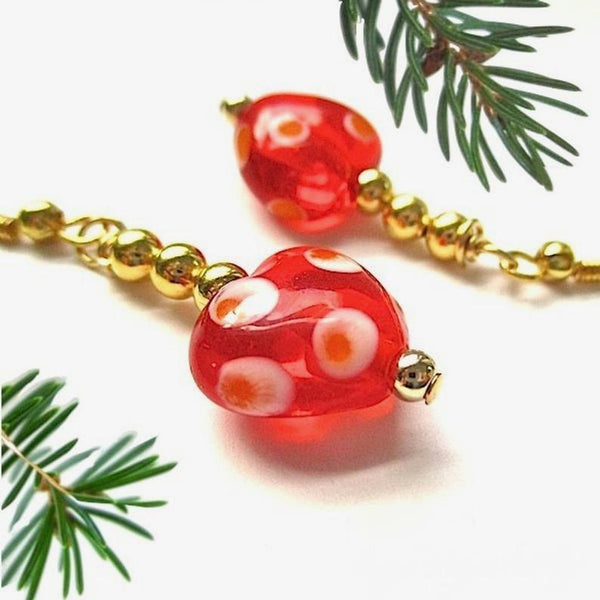 Colorful holiday earrings with red orange and white polka dot lampwork hearts, chunky dangles, gold beads and French hook earwires. Casual dressy everyday Christmas and Valentine's Day jewelry for women.