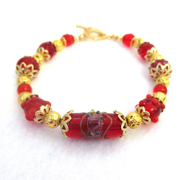 Red and Gold Beaded Chunky Bracelet, Christmas holiday and Valentine's Day jewelry for women, casual elegant design, lampwork wedding cake centerpiece, floral Art Nouveau Medieval Renaissance style, gold filigree beads, flower petal caps, romantic heart toggle clasp. Chunky handcrafted bracelet made in America by Rough Magic Holidays and J and M Handmade Jewelry of Down East Maine, USA