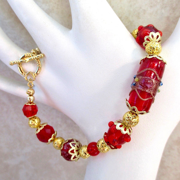 Red and Gold Beaded Chunky Bracelet, Christmas holiday and Valentine's Day jewelry for women, casual elegant design, lampwork wedding cake centerpiece, floral Art Nouveau Medieval Renaissance style, gold filigree beads, flower petal caps, romantic heart toggle clasp. Chunky handcrafted bracelet made in America by Rough Magic Holidays and J and M Handmade Jewelry of Down East Maine, USA.