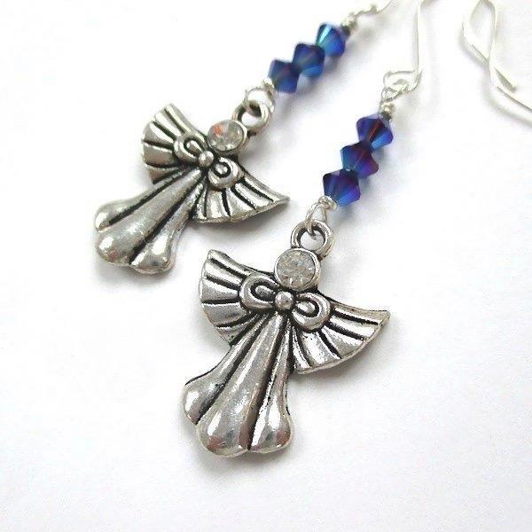Antiqued Silver Angels Christmas Earrings with Sapphire blue Swarovski crystals and sterling ear wires, clear rhinestone faces, handcrafted holiday jewelry for women and teenage girls. Designed and made in Down East Maine, USA, by Rough Magic Holidays and J and M Handmade Jewelry. Made in America.