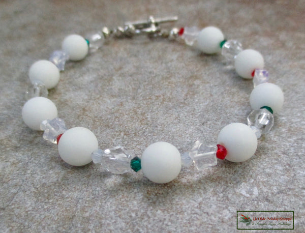 Christmas Bracelet with sea glass White Snowballs, Stars and Colorful Crystals, festive holiday jewelry for women and girls handmade by Rough Magic Holidays for Ye Old Holiday Shoppe on Prospero Lane
