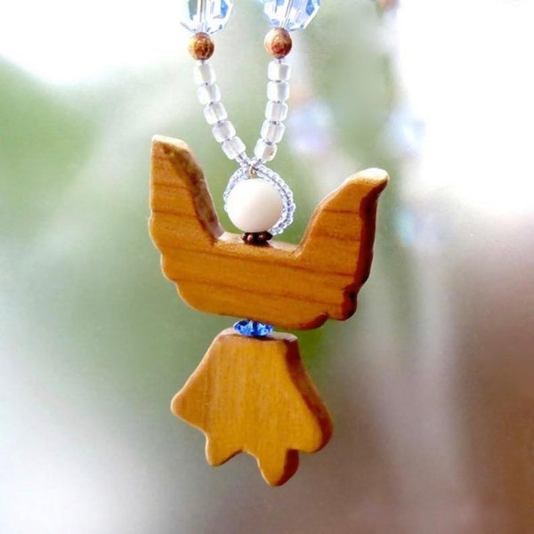 Unique wooden Christmas angel pendant on blue beaded necklace, hand carved natural wood, crystals, stars, copper, handmade holiday jewelry for women.