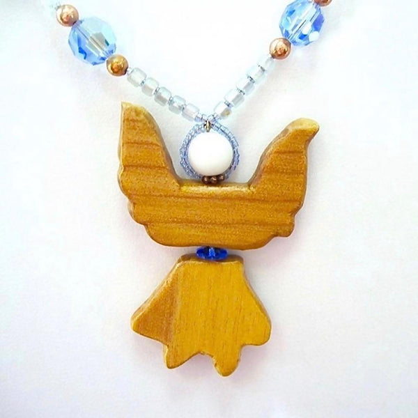Unique wooden Christmas angel pendant on blue beaded necklace, hand carved natural wood, crystals, stars, copper, handmade jewelry for women.