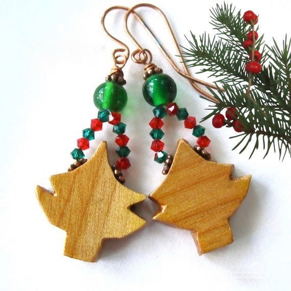 Hand carved natural wood Christmas trees, long dangle earrings with green glass beads, red and emerald Swarovski crystals and copper, make a festive statement in handmade holiday jewelry. Designed and handcrafted by Rough Magic Holidays for J and M Handmade Jewelry, they're made in America - in Maine, USA.