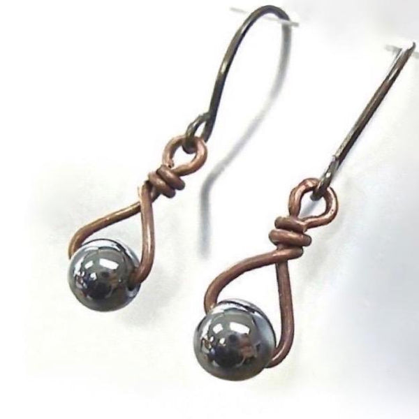"alt=""dark gray hematite earrings antique copper gemstones close up"""