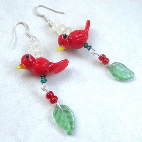 Christmas Earrings, extra long shoulder duster dangles with bright red lampwork birds, green glass leaves and frosted ice beads, silver French hook earwires, Swarovski emerald crystals, festive colorful Xmas, winter holiday, yuletide jewelry for women, made in America, Down East Maine, USA.