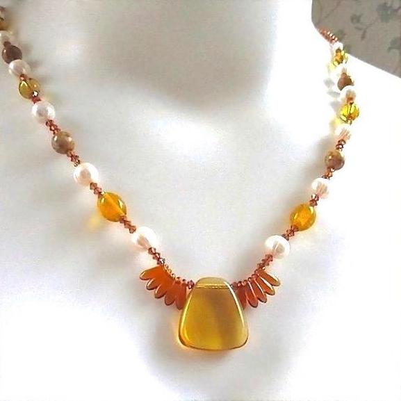"alt=""Warm Tones Dressy Necklace Amber Glass, Pearls, Copper Chain on model"""