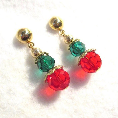 Red and green Christmas dangle earrings with gold dome posts and accents, handmade holiday jewelry for women.
