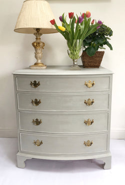 A Beautiful Vintage bow Chest Of Drawers Painted Pale Grey With White Wax