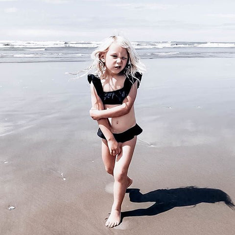 Luna Ruffle Girls Bikini in Black by CURRENT. Image via @kirsten.s.reid