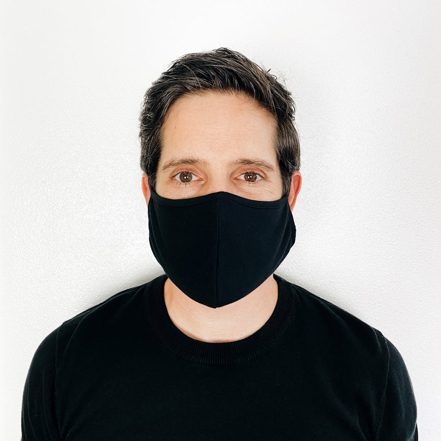 Unisex Adults Reusable Face Mask on man in Black by Current Label