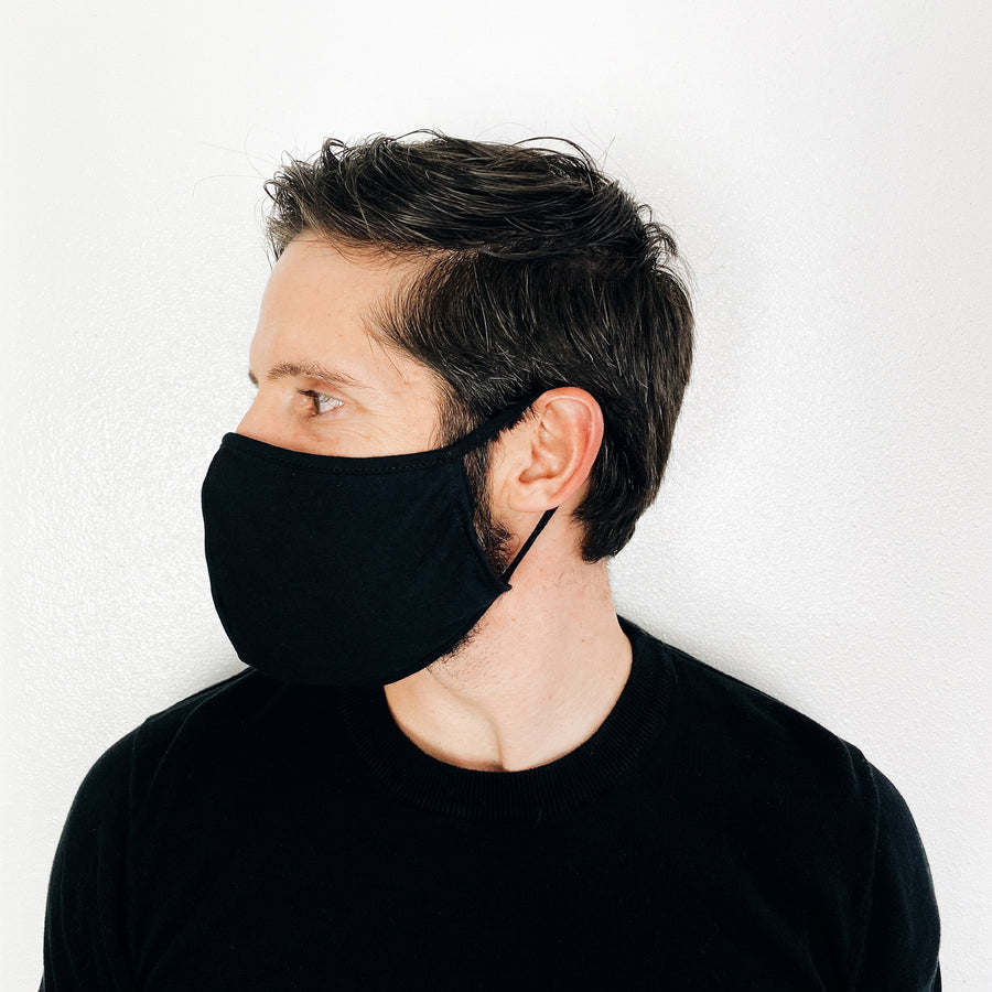 Unisex Adults Reusable Face Mask on man side view in Black by Current Label
