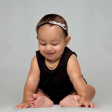 Tiny Leather Bow Headband in White and Black by CIALA Co at CURRENT
