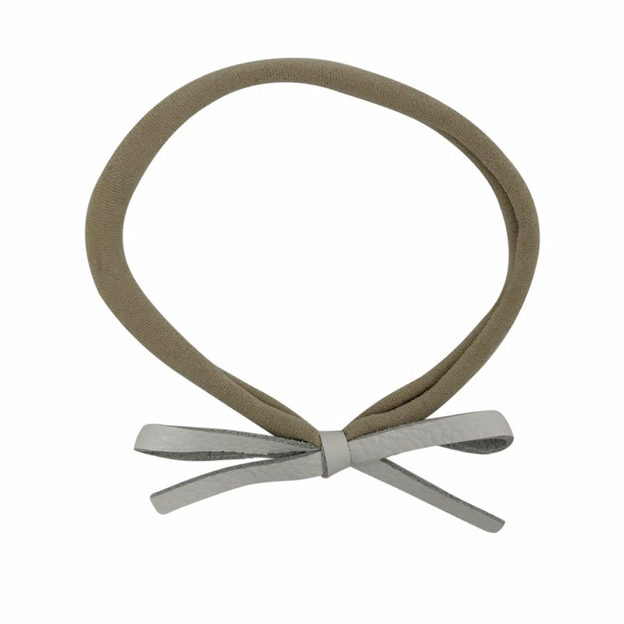 Tiny Leather Bow Headband in White and Nude by CIALA Co at CURRENT