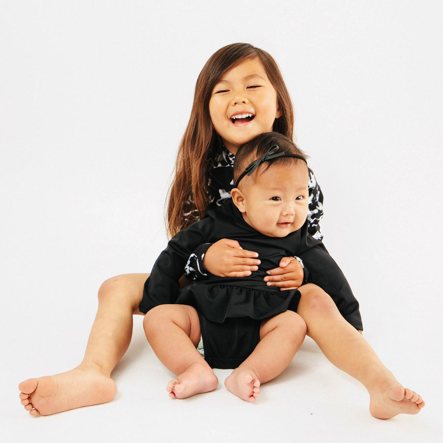Goldie Long Sleeve Ruffle Baby One Piece in Black