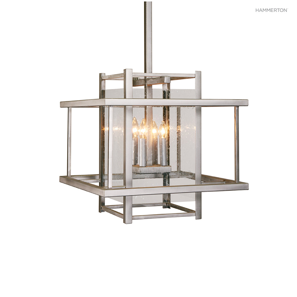 "CH2131 Architectural ""double box"" style chandelier in steel with glass interior lens and 4 candelabra socket bases. Available in 20+ finishes and a choice of glass lens options. American handcrafted to order. Can be customized in size, scale or materials."