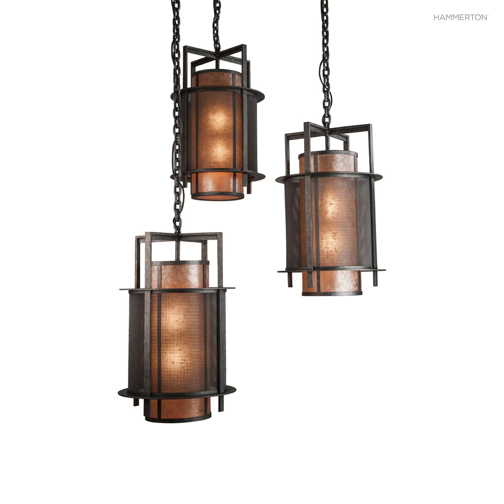 "CH2297 Contemporary chandelier featuring three 28""H Craftsman-inspired pendants suspended from a steel ring. Outer diffuser in fine mesh; inner diffuser in a choice of several acrylic, glass or mica lens materials. Available in 20+ finishes. American hand"
