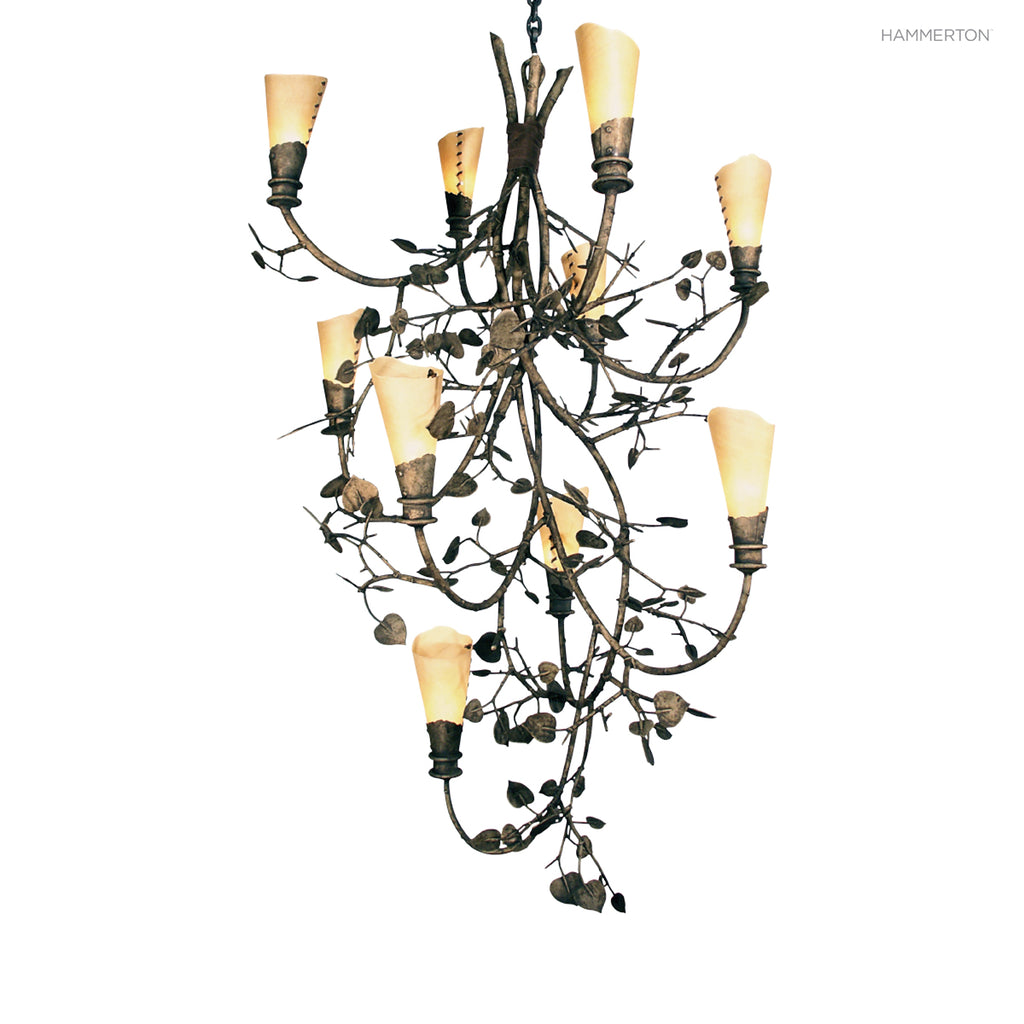 CH7166 Nature-inspired chandelier with a cascade of flower-like mica s and an organic motif meticulously hand-sculpted in steel. Available in 20+ finishes and a wide selection of motifs. Can be customized in size, scale or materials.