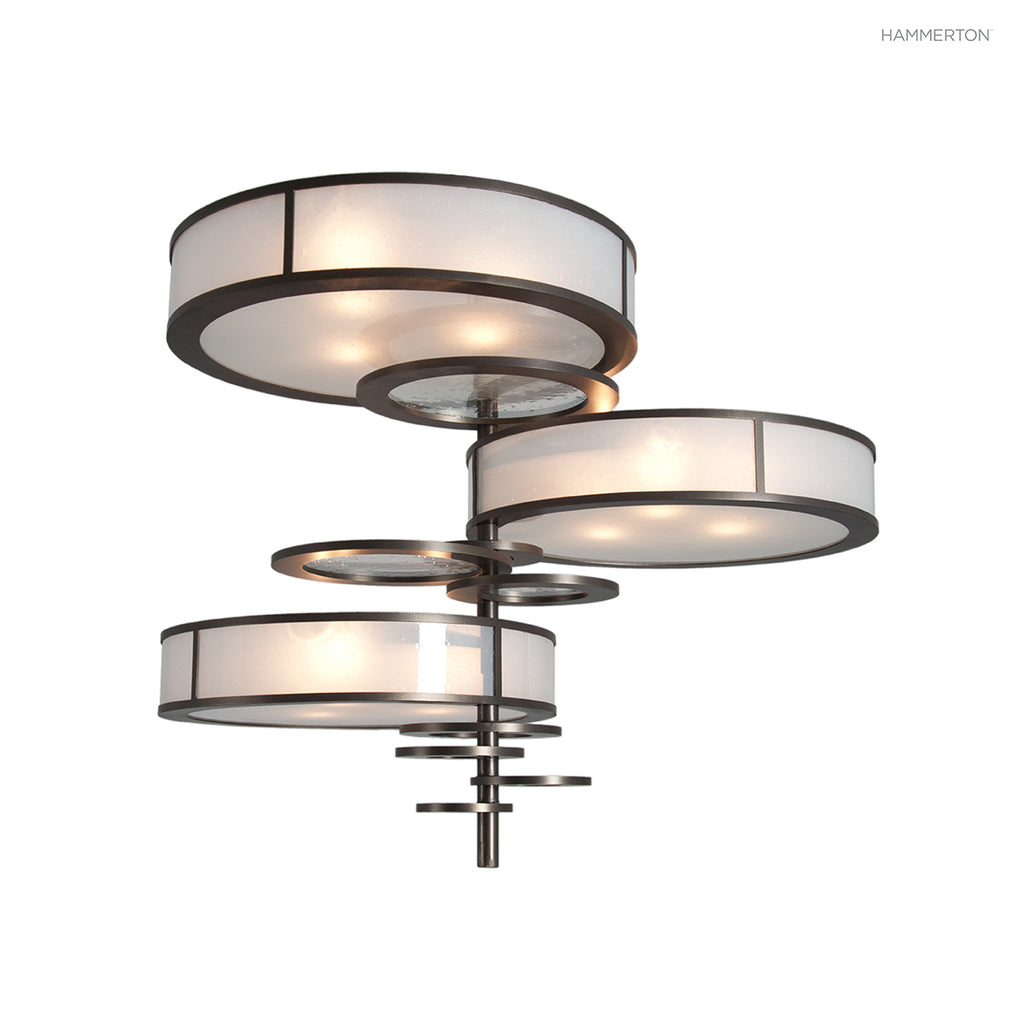 CHA2179 Large architectural contemporary chandelier featuring an asymmetrical assemblage of drums and discs with a unifying vertical axis. Available in 20+ finishes and a wide selection of lens materials in glass, mica and acrylic. American handcrafted to