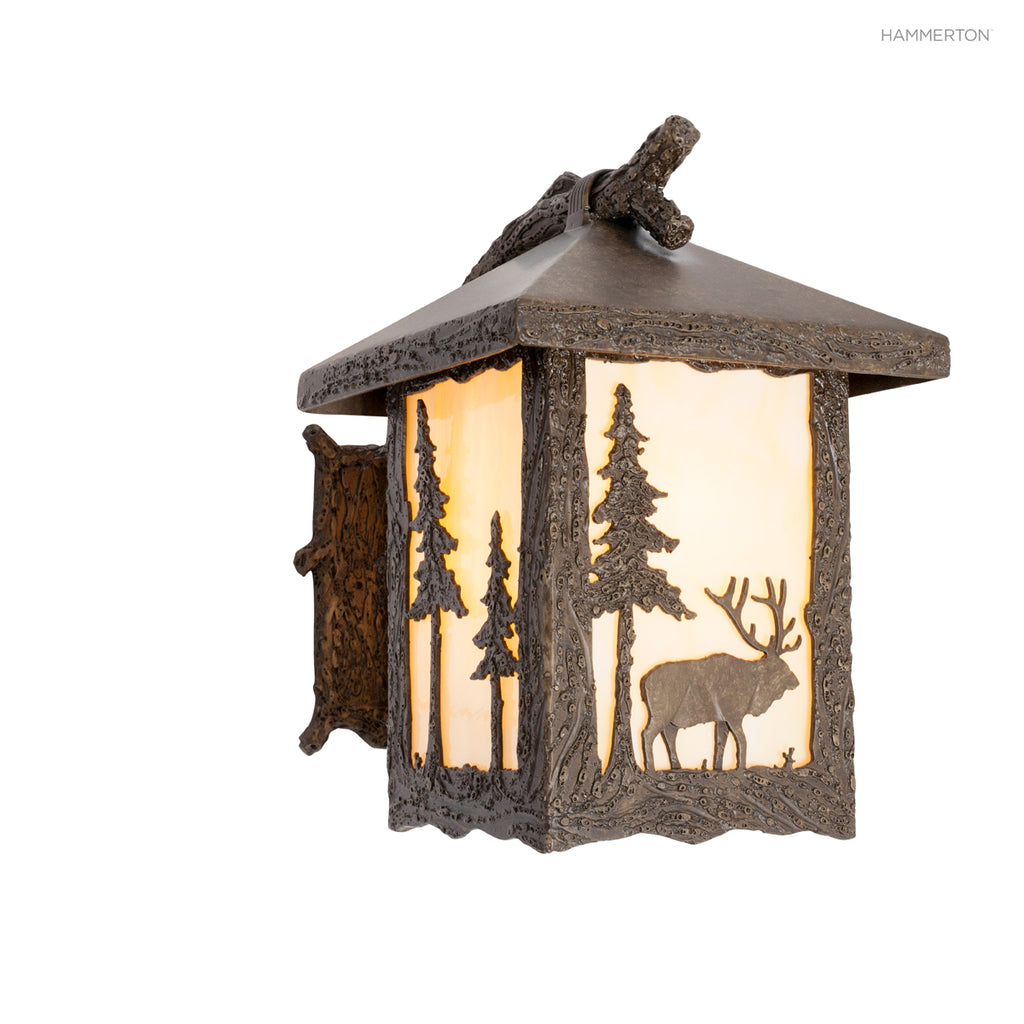OD6008-M Wildlife-inspired lantern sconce with a life-like textured 'branch' arm and meticulously handcrafted animal landscape motif silhouetted against a glass, mica or acrylic diffuser. Damp rated for outdoor use. Two sizes. Available in bear, deer, elk