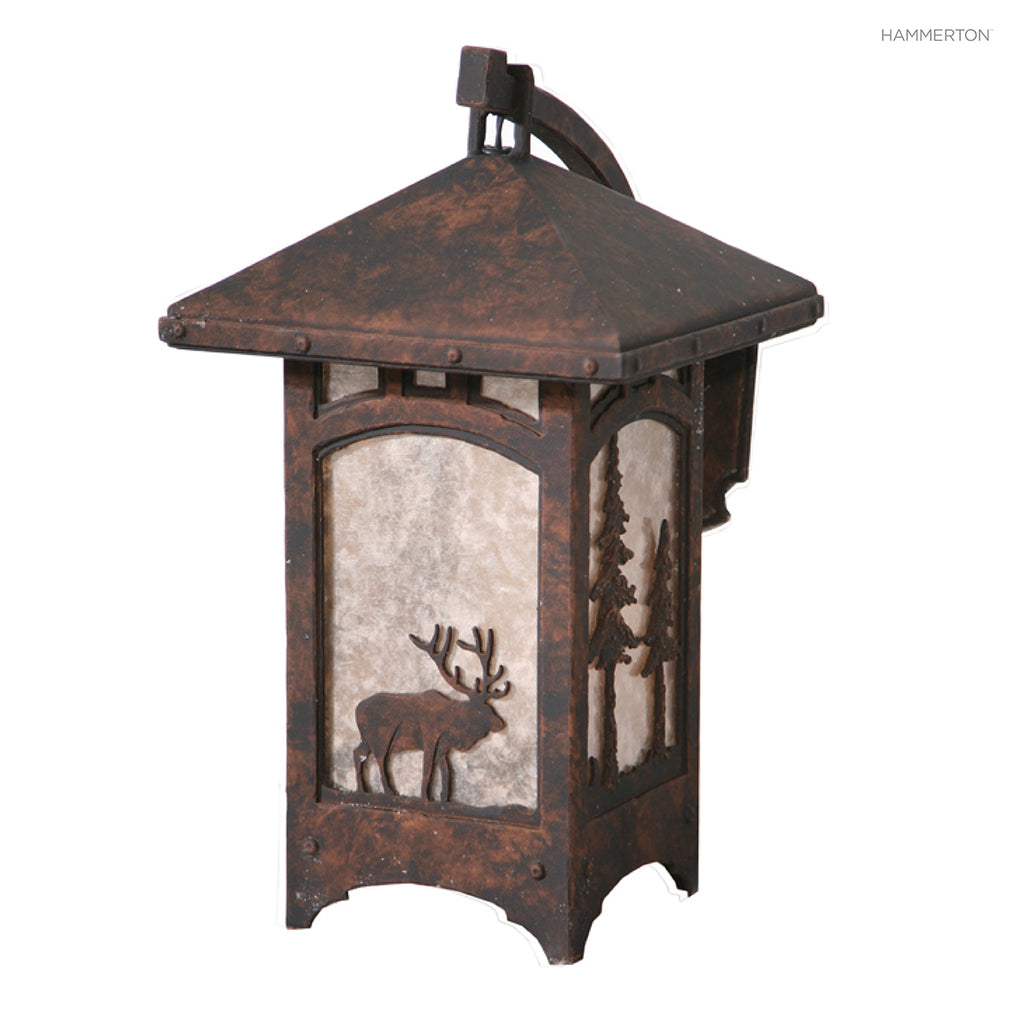 OD6032-M Wildlife-inspired lantern sconce with a meticulously handcrafted animal landscape motif silhouetted against a glass, mica or acrylic diffuser. Damp rated for outdoor use. Two sizes. Available in bear, deer, elk, horse, moose or wolf motif, as wel