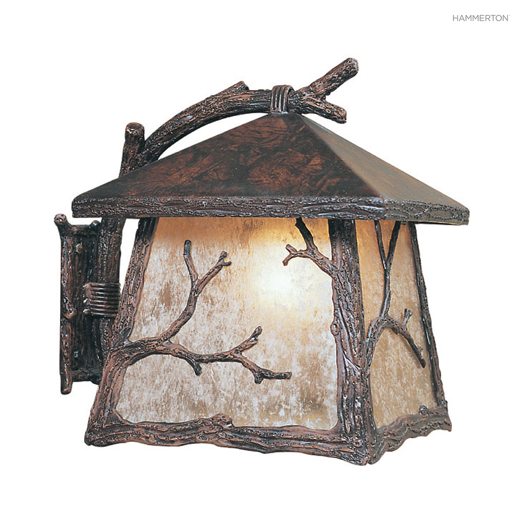OD7040-L Nature-inspired lantern sconce with square base, a life-like textured 'branch' arm and organic motif meticulously hand sculpted in steel. Damp rated for outdoor use. Available in Aspen, Pine, Branch, Maple or Oak motifs, a choice of lens options,
