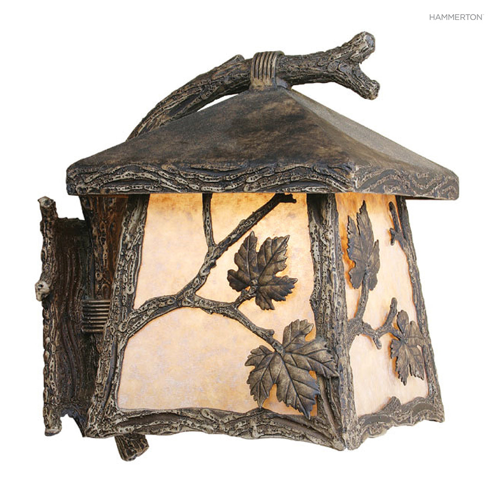 OD7040-M Nature-inspired lantern sconce with square base, a life-like textured 'branch' arm and organic motif meticulously hand sculpted in steel. Damp rated for outdoor use. Available in Aspen, Pine, Branch, Maple or Oak motifs, a choice of lens options,