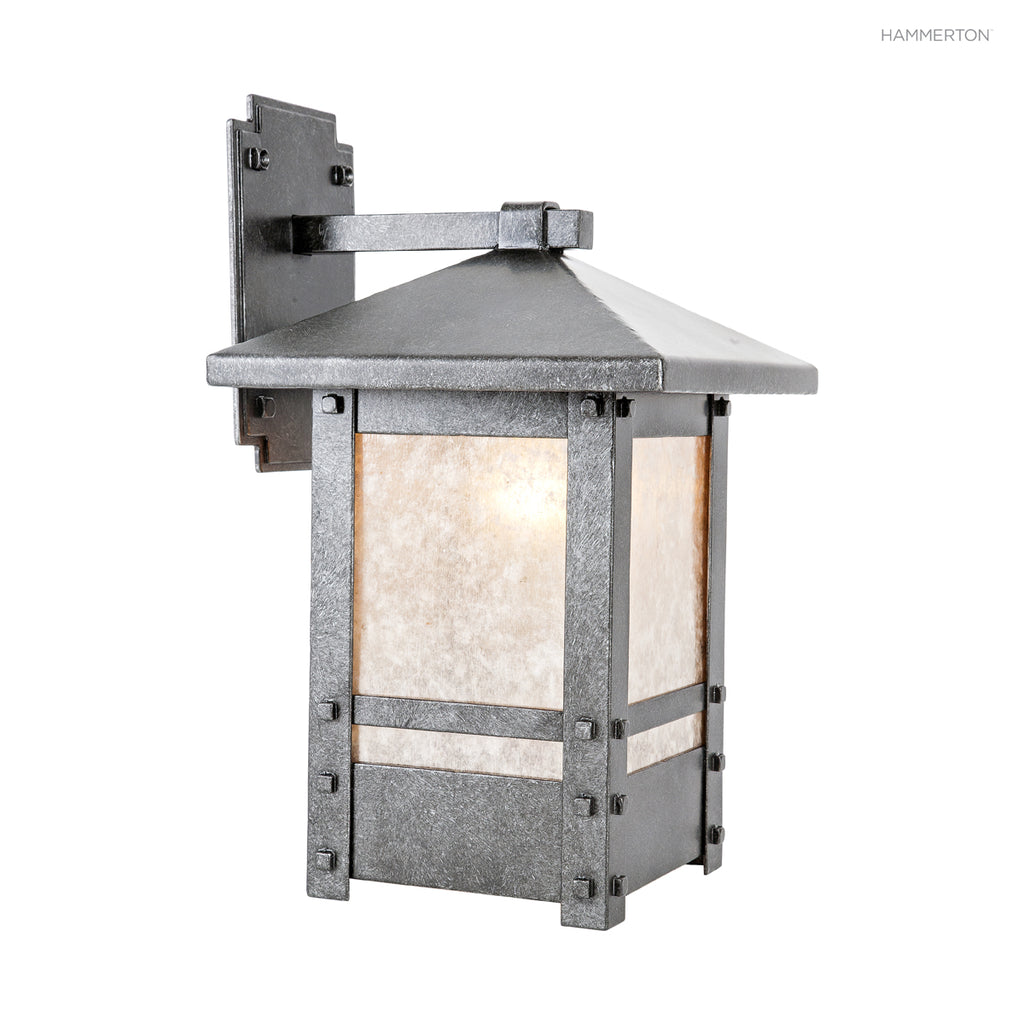 "OD8034-M Craftsman-inspired lantern arm sconce with square base and handcrafted pin and strap details. Damp rated for outdoor use. Available in two sizes, several glass, mica or acrylic diffuser options and 10+ finishes. Small: 19""H x 10""W x 13""D; Medium:"