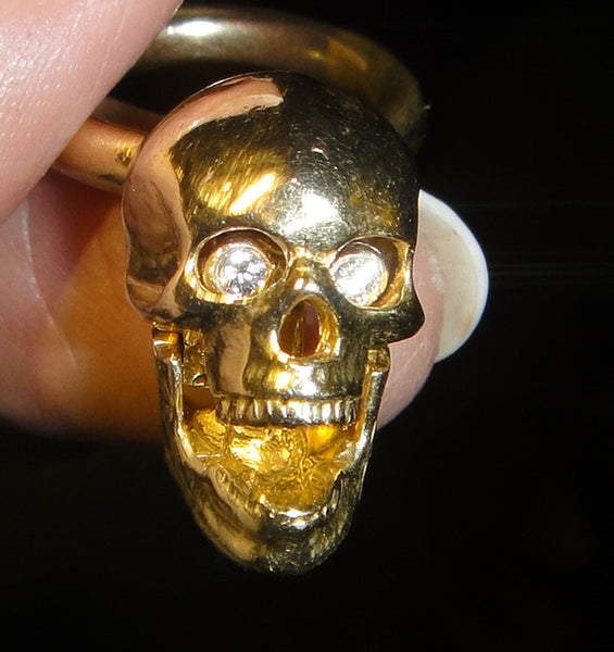 14K GOLD SKULL ENHANCER.