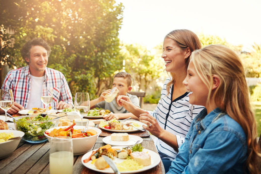 People eating outdoors at a table